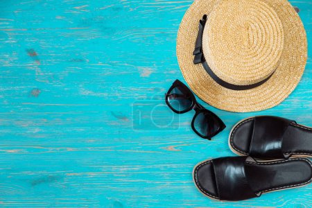 Photo for Travel concept. copy space. beach stuff on blue wooden background - Royalty Free Image