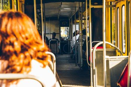 Photo pour Tramway à l'intérieur. passagers dans le transport urbain. journée ensoleillée - image libre de droit