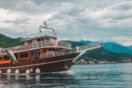 Photo for People on travel boat in kotor bay, montenegro. overcast weather - Royalty Free Image