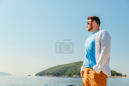 Photo for Man portrait with sea and land on background . summer vacation - Royalty Free Image