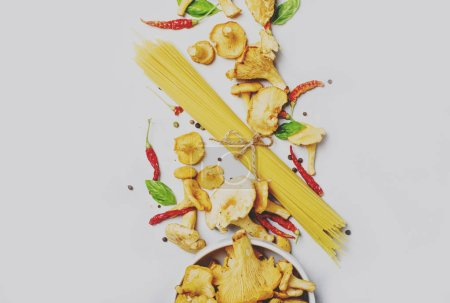Photo for Ingredients for cooking pasta with mushrooms chanterelles in a creamy sauce, food background, top view - Royalty Free Image