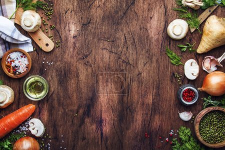 Photo for Ingredients for cooking green lentils with mushrooms and vegetables, spices and herbs, vintage wooden kitchen table background, place for text. Vegan or vegetarian food, clean food concept. Top view, flat lay - Royalty Free Image