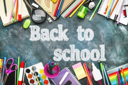 Photo for Back to school background with text chalk imitation, notebooks, pens, pencils, other stationery on blue chalk board desk, education concept, flat lay, top view - Royalty Free Image