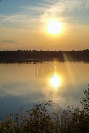 Photo for Dramatic and colorful sunset over a forest lake reflected in the water. Blakheide, Beerse, Belgium. High quality photo - Royalty Free Image
