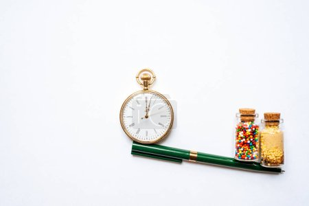 Photo for Stopwatch and candies on background, close up - Royalty Free Image