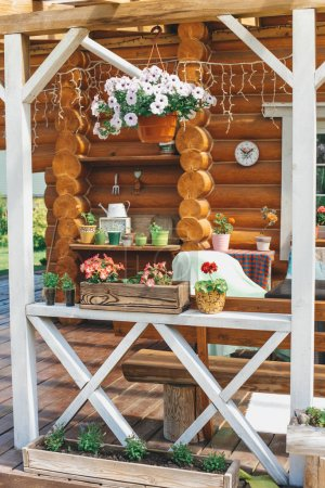 Photo for Beautiful wooden house in the garden on background - Royalty Free Image