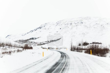 Photo for Beautiful and dangerous driving road in winter snow Iceland - Royalty Free Image