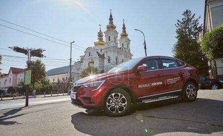 Photo for Vinnitsa, Ukraine - Septembert 16, 2020. Renault Arkana - new model car presentation in showroom - test drive in city - Royalty Free Image