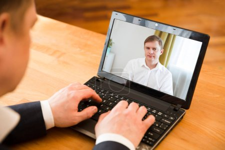 Photo pour Online conference. businessman using laptop making video call to business partner. Home office. Working from home. - image libre de droit