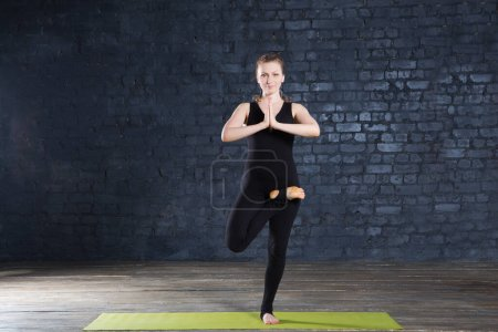 Photo for Portrait of beautiful young woman practicing yoga in urban wall. A series of yoga poses. Fitness, sport, yoga - concept. - Royalty Free Image