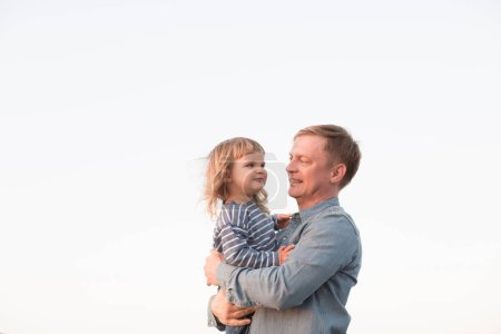 Photo for Happy father plays with his baby - Royalty Free Image