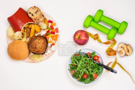 Photo for Junk food vs sport and healthy lifestyle concept. Preparing a body for vacation time in summer. Copy space - Royalty Free Image