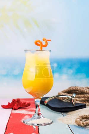 Photo for Summer holiday vacation background with mango juice, flip flop and star fish over the sea - Royalty Free Image