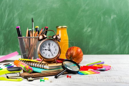Photo for School statonery on green blackboard background. Back to school concept. Copy space - Royalty Free Image