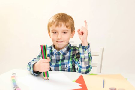 Photo for Cute little boy drawing at home. Children's creativity. Creative kid painting at preschool. Development and education concept.Happy kid drawing with colorful pencils. Art workshop for kids - Royalty Free Image