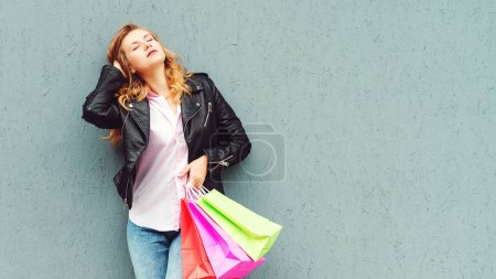 Photo for Stylish girl enjoying after great shopping. Shopper woman holding shopping bags. - Royalty Free Image