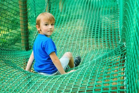 Photo for Little happy boy having fun in adventure park. Child playing at outdoors playground. - Royalty Free Image