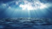Dark blue ocean surface from underwater.