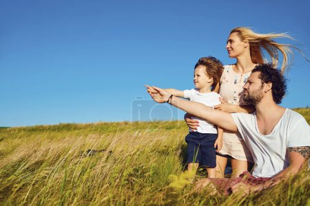 Photo for Happy family together in nature against the blue sky. - Royalty Free Image