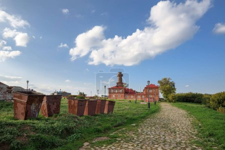 Dumpsters in front of the historical building of the fire house of the 19th century. Sviyazhsk, Republic of Tatarstan, Russia.