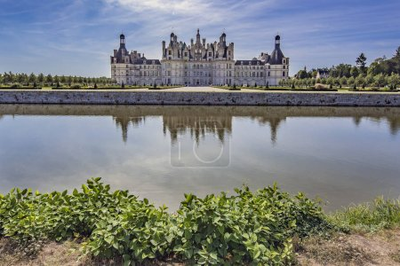 Chambord Castle reflected in the surrounding water