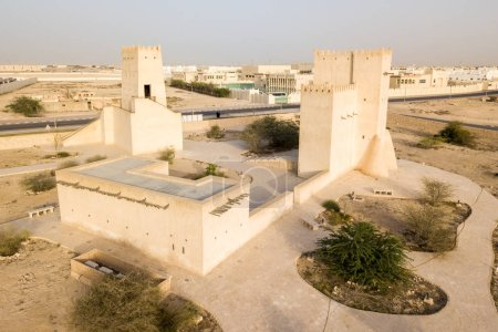 Barzan watchtowers built with coral rock and limestone, Umm Salal Mohammed Fort Towers, an ancient Arabian fortification near Umm Salal Muhammad town and Doha city, Qatar. Aerial drone foto.