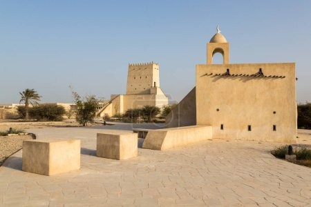 Barzan watchtowers and an Old mosque built with coral rock and limestone, Umm Salal Mohammed Fort Towers, ancient Arabian fortification near Umm Salal Muhammad town and Doha city, Qatar.