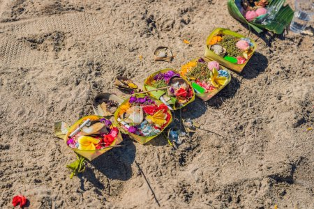 Hindu offerings and gifts to god on the beach in Bali, Indonesia.