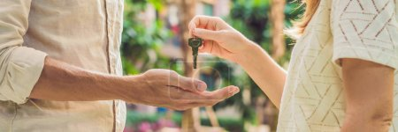 Real estate agent giving keys to apartment owner, buying selling property business. Close up of male hand taking house key from realtor. Mortgage for purchasing flat, getting access to own home. BANNER, long format