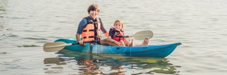 Father and son kayaking at tropical ocean. Travel and activaties with children concept. BANNER, long format