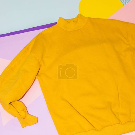 Photo for Woman's yellow pullover on memphis style background. Geometry minimal concept. Fall and winter fashion. - Royalty Free Image
