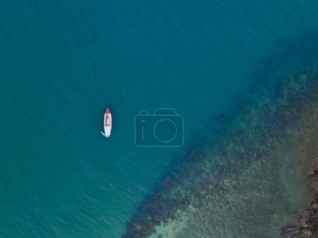 Photo for Small boats fishing in the blue ocean - Royalty Free Image