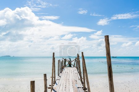 Photo for Old wooden pier leading out to the blue ocean - Royalty Free Image