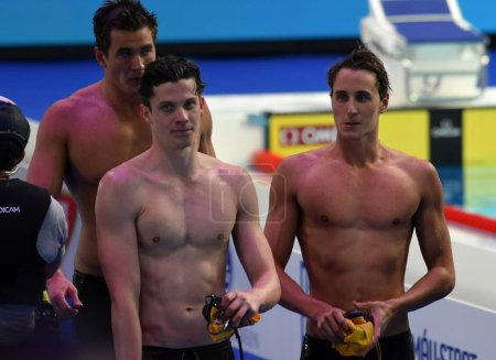 Budapest, Hungary - Jul 27, 2017. MCEVOY Cameron (AUS), CARTWRIGHT Jack (AUS) and ADRIAN Nathan (USA) after the 100m Freestyle Final. FINA Swimming World Championship was held in Duna Arena.