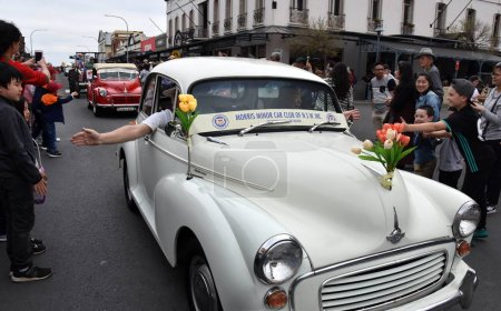 Bowral, Australia - Sept 22, 2018. Tulip Time Street Parade features classic and vintage cars, marching bands and various floats. Locals and visitors line the street to celebrate Spring.