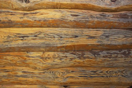 background of a wall of boards of natural brown wood
