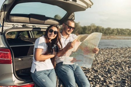 Photo for Happy Couple on Roadtrip into the Sunset in SUV Car - Royalty Free Image