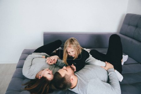 Photo for Happy parents and daughter spending time together at home - Royalty Free Image