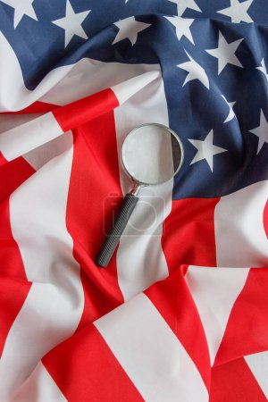 Photo for Magnifying glass on the national flag of United States of America, background, top view - Royalty Free Image