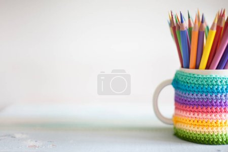 Photo for Colored pencils in a pencil case on workspace and workshop background - Royalty Free Image