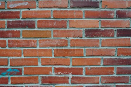 wide red shabby brick wall structure