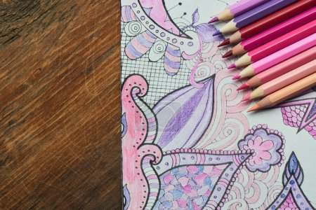 coloring page with pencils in pastel pink and purple colors, close-up