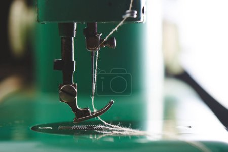 sewing machine with needle and thread, close-up view