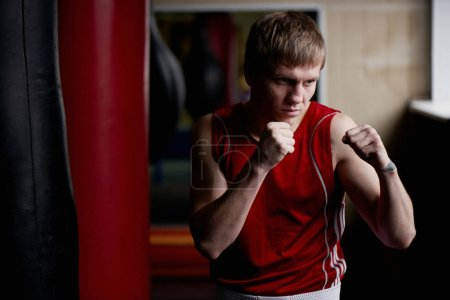 Photo for Blond kickboxer training in gym - Royalty Free Image