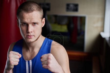 Photo for Handsome boxer in sportswear working out in gym - Royalty Free Image