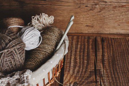 Photo for Needlework, macrame, knitting. Yarn and thread of natural colors in a wicker basket. Women's hobby. - Royalty Free Image