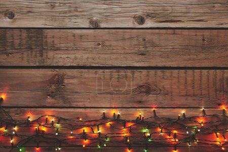 Photo for Christmas garland on wooden background with copy space. - Royalty Free Image
