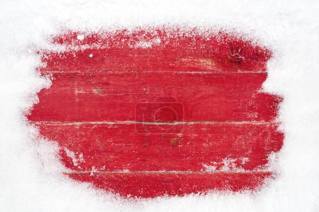 Photo for Snow frame on red wooden background - Royalty Free Image