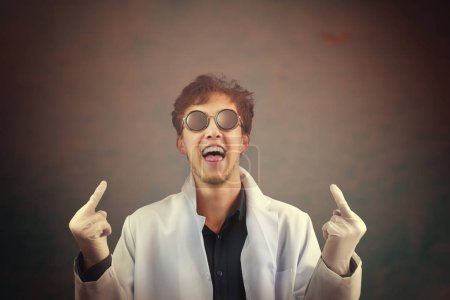 Crazy laughing man doctor giving you fingers