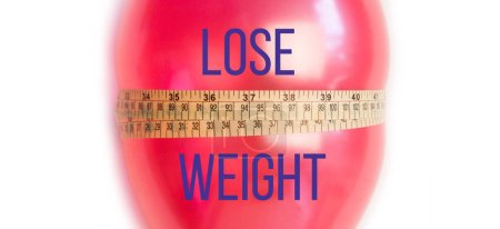 Idea of weight loss. Balloon with measuring tape. Lose weight text